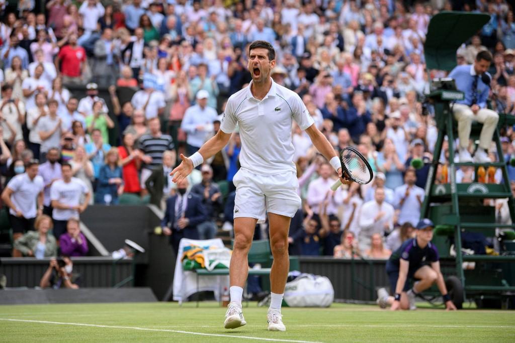 64tnj9to novak djokovic wimbledon afp 625x300 11 July 21 - Novak Đoković s tretjo zaporedno zmago na turnirjih za Grand Slam izenačil Federerja in Nadala!